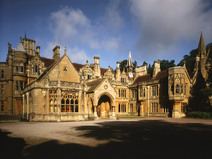 View of the East Front of Tyntesfield, showing entrance door and turreted roofs of this Victorian Gothic Revival house in tinted Bath stone, designed by John Nortonn 1863-66