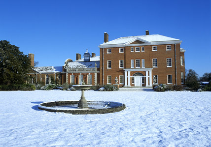 A view across the snow covered west lawn of the House at Hatchlands