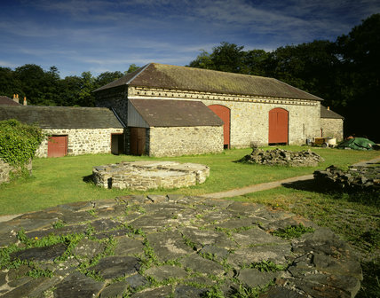 The Rick yard with rickstands & threshing barn at Llanerchaeron, an C18th Welsh estate in the Dyffryn Aeron; the house designed and built by John Nash 1794-6, the estate is self-sufficient