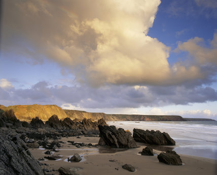 A view of Marloes Sands, Pembrokeshire from the western end looking east in evening light