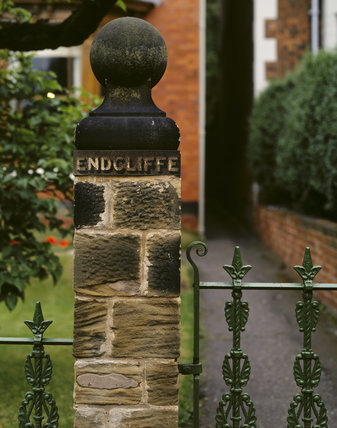 Gatepost of Mr Straw's House, with the house name