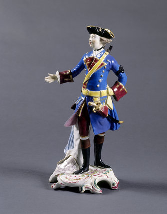 Bow figurine of Wolfe standing proud with his right arm raised and his left hand on his hip