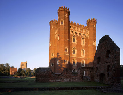 The west front of the Great Tower with the Church & Stable ruins in the last light of the day