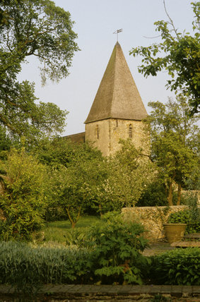 A view through the garden from the house looking towards to the spire of Rodmell Village Church
