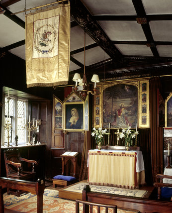 Room view of the Chapel looking towards the altar, window and banner