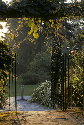 A view of the Gateway looking towards the miniature sundial from the Pergola at Mount Stewart Garden
