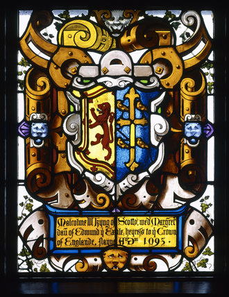 Detail of Thomas Willement's 19th-century heraldic stained glass from the Dining Room at Charlecote, depicting the arms of King Malcolm III of Scotland with those of his wife, Margaret