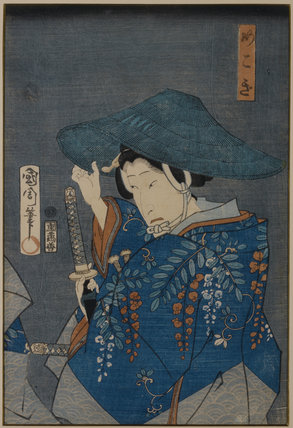 A Japanese Print, showing a woman with a sword and a hat one of a collection of prints housed at Standen