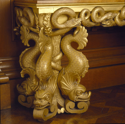 Detail of the carved and gilt side table at Penrhyn Castle by Hopper, showing dragon fish and snakes