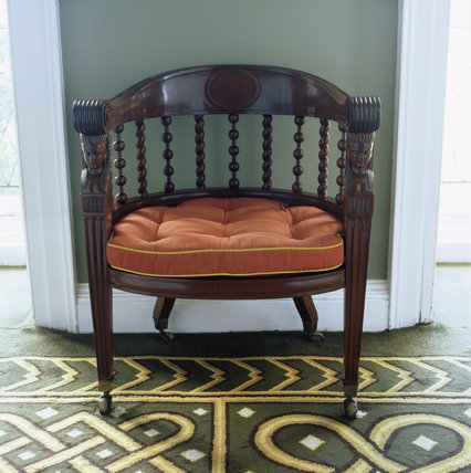 Full view of a Chippendale chair with Egyptian heads in the Library at Stourhead