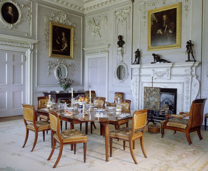 A room view of the Dining Room at Felbrigg Hall formed by James Paine in 1752 and has portraits of the Windham family hanging on the walls