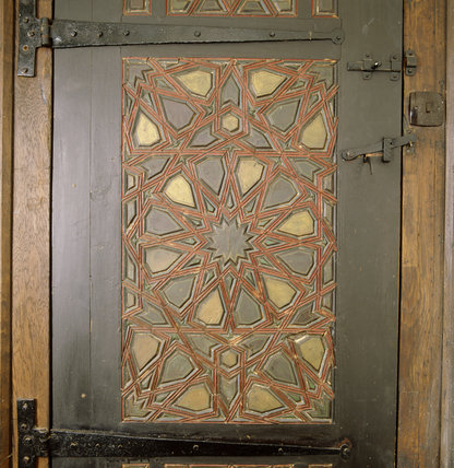 Carved and painted decoration on back of the door in the Bedroom at Stoneacre
