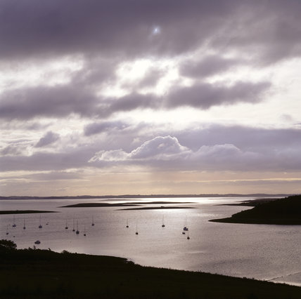 Sunrise over Ballymorran Bay, Strangford Lough with small boats in the water