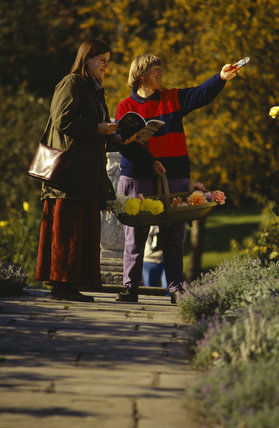A volunteer gardener and visitor in the garden at Chartwell
