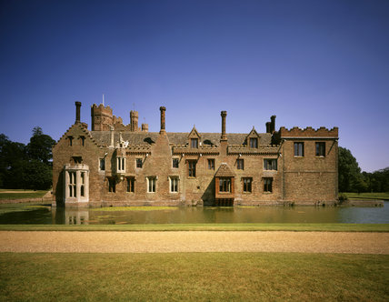 The west front of Oxburgh Hall seen from across the moat