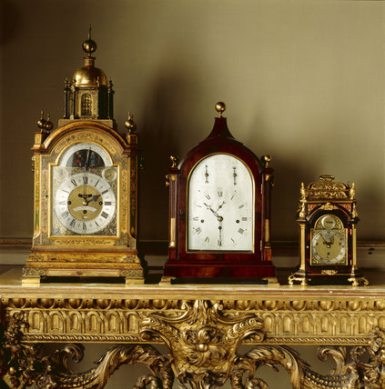 Three clocks from the collection in the Clock Room at Lyme Park