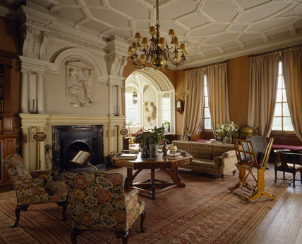 The Library at Lyme Park, showing the fireplace, chimneypiece window bay, mahogany table and early C19th