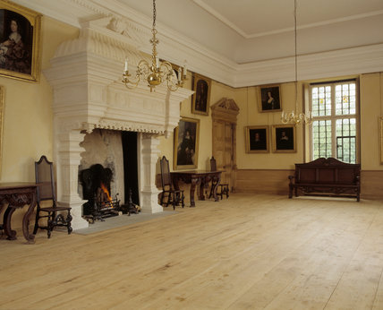 View of the Great Room showing fireplace, William Kent style bench, window & floor