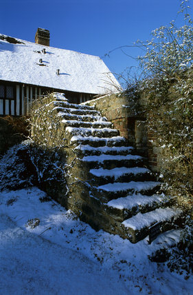 Snow covered garden steps at Ightham Mote