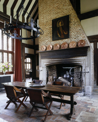 Towards fireplace, with spit and cauldron
