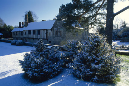 The north west aspect of Ightham Mote after early morning snow