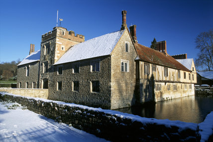 Looking across the moat to the N.W. aspect of Ightham Mote, under a blanket of early morning snow.