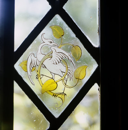 Stained glass panel of bird in window of Great Hall at Stoneacre, a medieval Wealden house in Kent