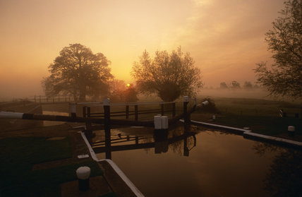 Sunrise through early morning spring mist at Papercourt Lock