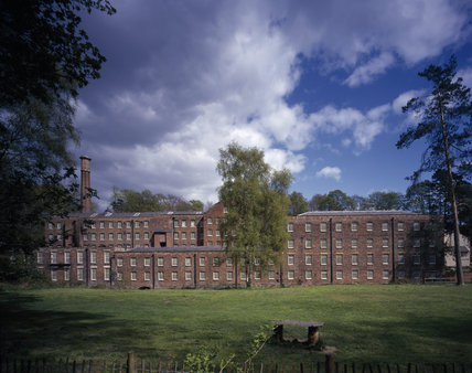 An impressive view of the extent of Quarry Bank Mill in summer