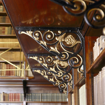 Close-up of the iron brackets supporting the walk-way of the second tier in the Dante Library