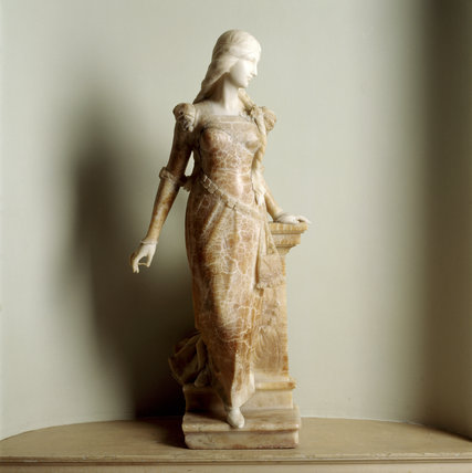 A C18th. marble figure of a lady in the Staircase Hall