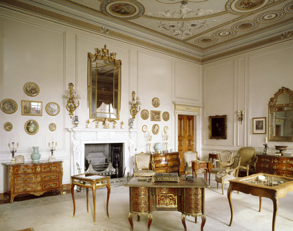 The white marble fireplace in the Drawing Room flanked by two commodes with the Regence Boulle writing desk holding the Comte de Flahaut's pen tray in the foreground