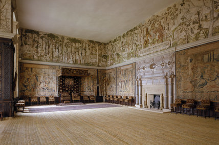 Room view of the High Great Chamber at Hardwick Hall showing the tapestries and the plasterwork frieze