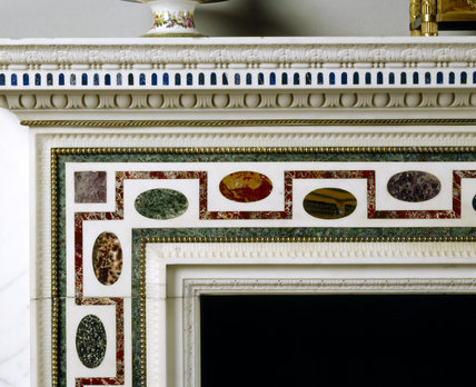 Close-up of the top left hand corner of the Italian chimneypiece in the Drawing Room at Ickworth, showing the oval inserts of coloured marble