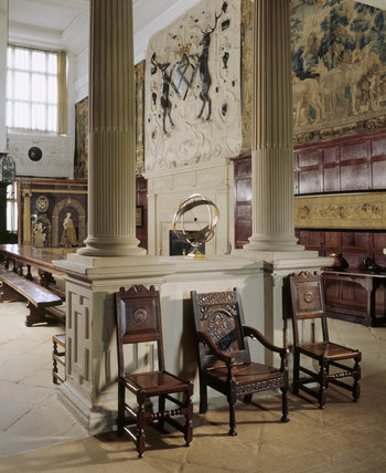 Room view of the Great Hall at Hardwick Hall showing the classical columns, carved by the mason William Griffin and Bess of Hardwick's arms above chimneypiece by Abraham Smith