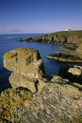Looking along the rocky cliffs of the Lizard Peninsula, to the Lighthouse on the distant headland