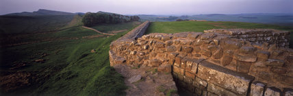 Houseteads Roman Fort, looking towards Sewing Shield Crags with Hadrian's Wall washed in a bright rose light