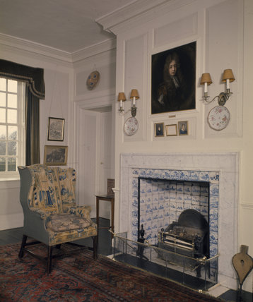 The hall chimneypiece at Gunby Hall showing some framed lines of verse, supposedly written by Tennyson about Gunby Hall