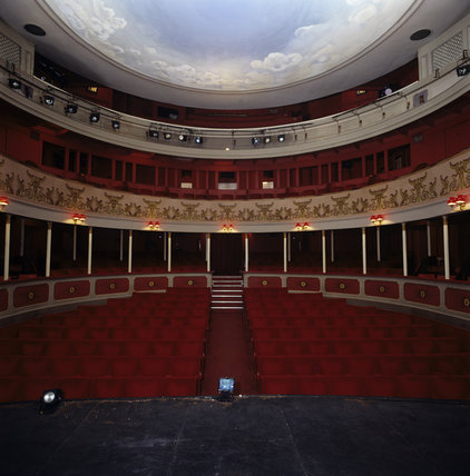 View into the empty auditorium of the Theatre Royal, Bury, looking out to the painted sky ceiling