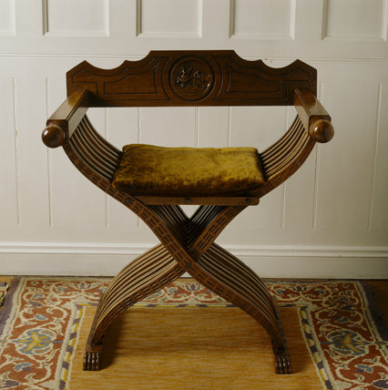 Walnut x-framed `Savonarola' chair in the Staircase Hall