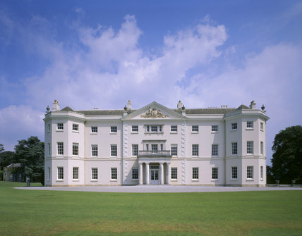 The south front of Saltram, with the Coat of Arms above the Doric portico