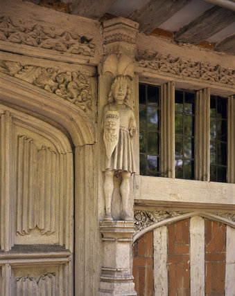 Close detail of the timber carving (original figure) on the front of the house