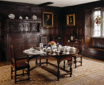 Room view of the Dining Room showing the late c17th oak gate-leg, George IV period Carey's Ironstone dinner service and glass made in the late c16th which commemorates several marriages