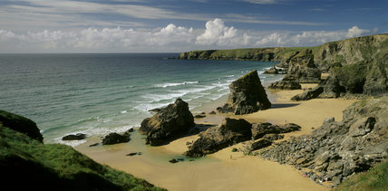 View of the beach (not NT) at Bedruthan Steps from Carnewas in the south looking north to Park Head promontory