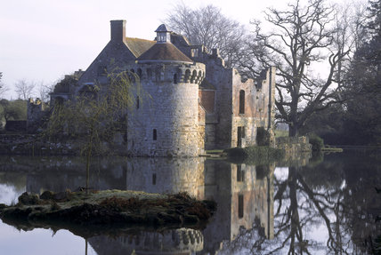 The romantic Castle ruins seen in the early morning from across the Moat