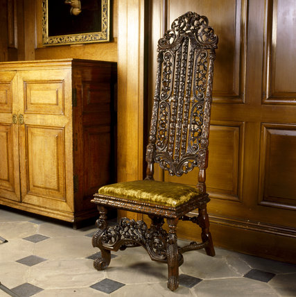 A carved walnut chair, from the Great Hall at Dunham Massey