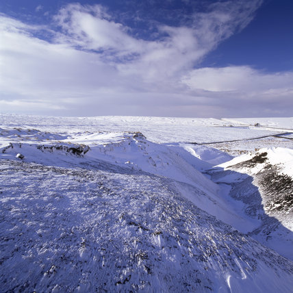 Looking west from near Pule Hill over the snow covered landscape toward Standedge