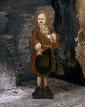 An early eighteenth century painted dummy board from the Great Chamber at Trerice, depicting a boy holding a hat