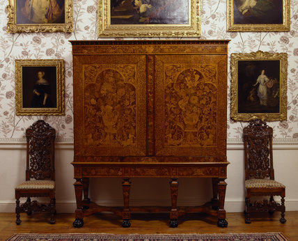 A large floral marquetry cabinet & high back Dutch style chairs, in the Chinese Dressing Room