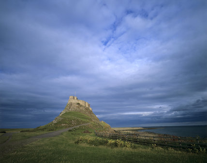 Lindisfarne Castle with a stormy sky behind